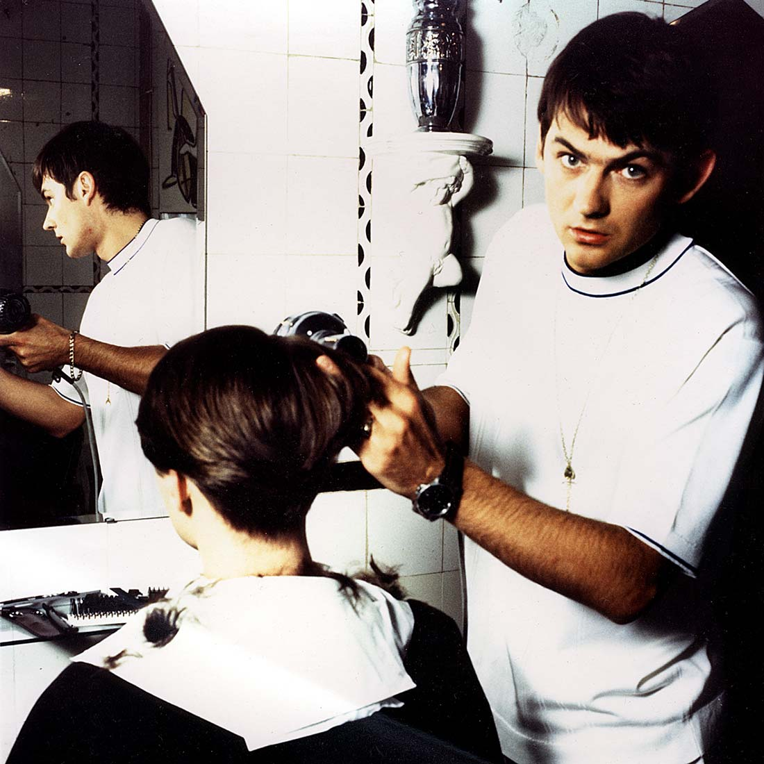 Paul Burfoot at work cutting hair